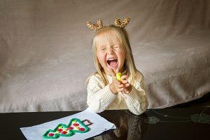 Girl makes christmas tree at ST Mark's Harrogat